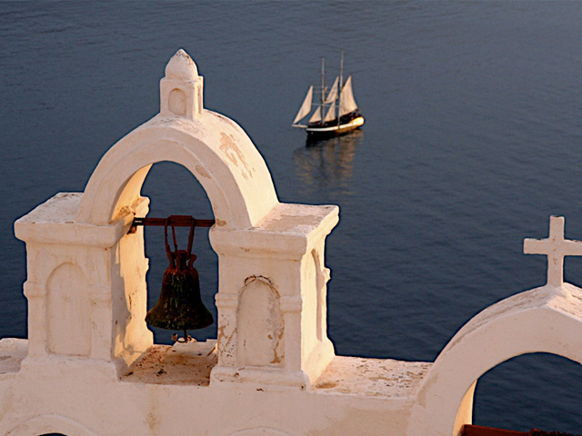 Oia community on the islands of Thira (Santorini) and Therasia, and view on the Aegean Sea, in the Cyclades, Greece