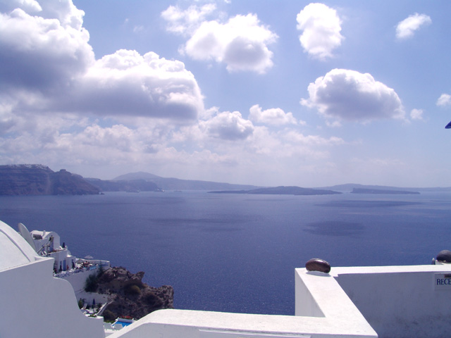 Panoramic view of Santorini island from Oia (Greek Οία) on the islands of Thira (Santorini) and Therasia, in the Cyclades, Greece