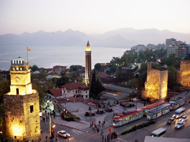 The clock tower and the Yivli Minare in the city center, Antalya, Turkey