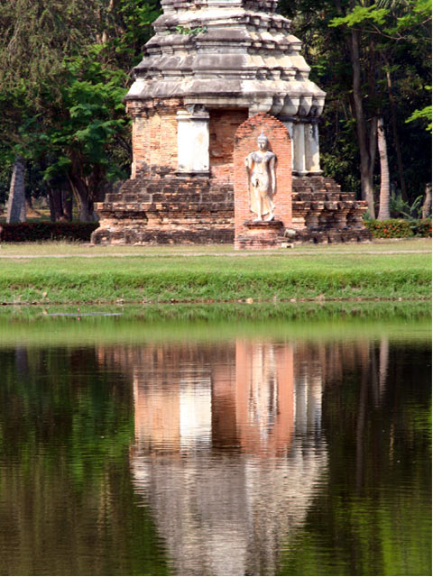 Statue and Chedi on water